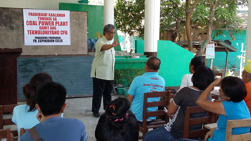 Father Espridion Celis supports power plant